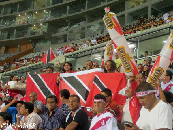 Photo: Trinidad and Tobago football fans represent in Lima. (Courtesy Juliet Solomon/Wired868)
