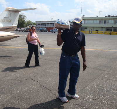 Photo: Ex-FIFA vice-president Jack Warner delivers bottled water to Haiti. The Haitian football president said he wasn't as generous with their money, though.
