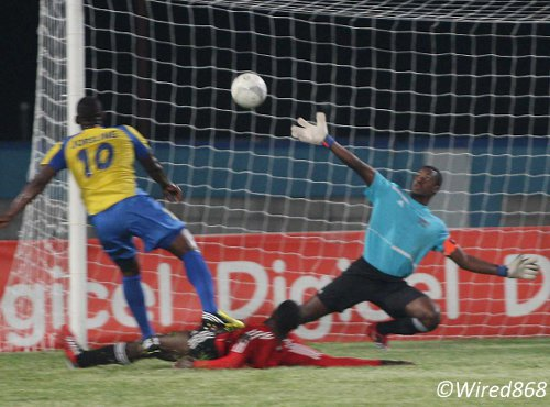 Photo: Defence Force star striker Devorn Jorsling (left) hammers past Central FC goalkeeper Marvin Phiilip (right) while defender Keion Goodridge makes a vain effort to intervene. (Courtesy Wired868)
