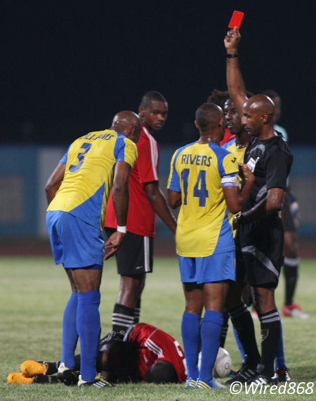 Photo: Referee Neal Brizan (far right) ejects Defence Force midfielder Keston Williams (far left) during a Pro League fixture last season while Central FC attacker Jason Marcano lies in pain (Courtesy Wired868)