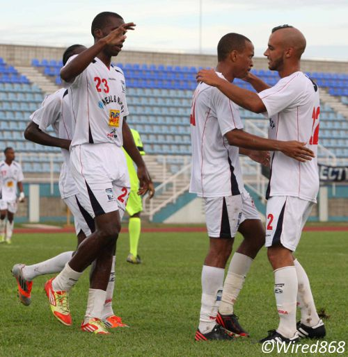 Photo: Caledonia AIA playmaker Densill Theobald is embraced by Argentine teammate Miguel Romeo (right) while Jamal Gay congratulates his fellow scorer. (Courtesy Wired868)