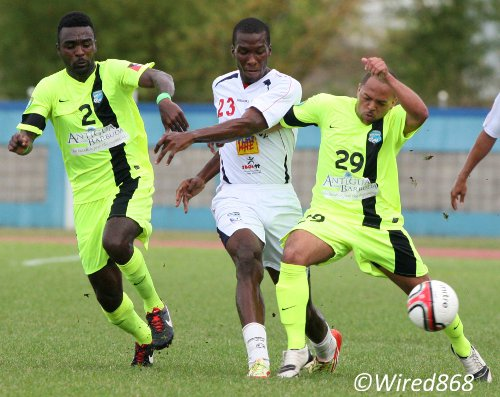 Photo: Caledonia AIA striker Jamal Gay (centre) battles for the ball with Antigua Barracuda midfielders Andre Manders (right) and Toric Robinson during the Champions League qualifying rounds. (Courtesy Wired868)