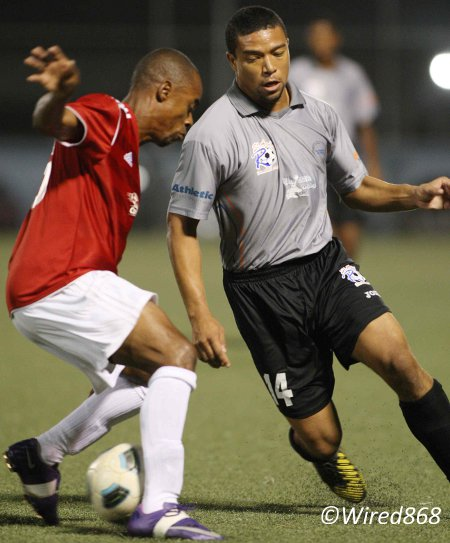 Photo: St Ann's Rangers attacker Cameron Roget (right) eludes Central FC defender Carey Harris on Tuesday. (Courtesy Wired868)