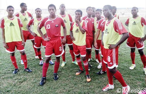 Photo: Trinidad and Tobago national under-17 captain Brendon Creed (fourth from left) takes a breather with his teammates during training. (Courtesy Victoria Walcott/Wired868)