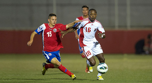 Photo: Trinidad and Tobago midfielder Levi Garcia (right) takes on a Costa Rican opponent during the 2013 Under-17 CONCACAF tournament. (Courtesy CONCACAF.com)