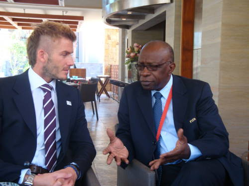 Photo: England star David Beckham (left) holds court with ex-FIFA vice president Jack Warner.