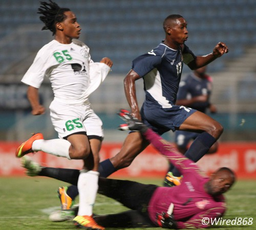 Photo: W Connection attacker Neil Benjamin Jr (left) strikes against Defence Force last season despite the efforts of goalkeeper Kevin Graham and his teammate Ross Russell Jr. (Courtesy Wired868)