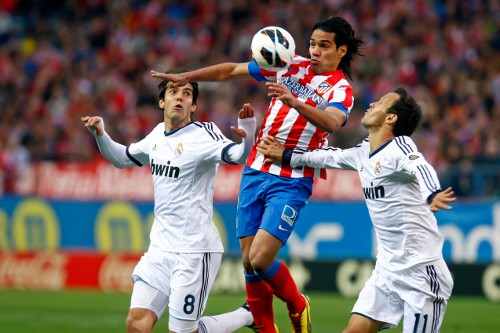 Photo: Atlético Madrid and Colombia star striker Radamel Falcao (centre) controls the ball between Real Madrid attacker Kaka (left) and defender Ricardo Carvalho.