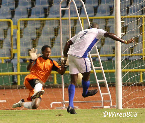 Photo: St Ann's Rangers goalkeeper Zane Coker (left) makes a crucial save in a TTFF FA Trophy fixture against WASA FC last season. (Courtesy Wired868)
