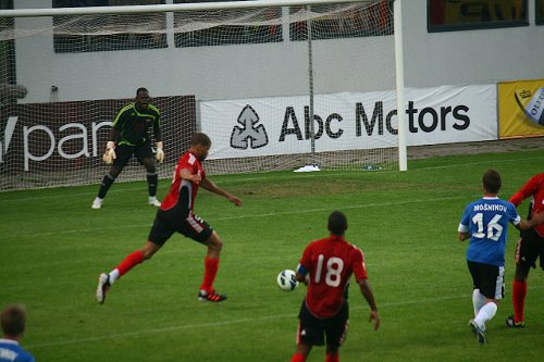Photo: Trinidad and Tobago defender Radanfah Abu Bakr executes a clearance while goalkeeper Jan-Michael Williams (background) and midfielder Densill Theobald (number 18) look on. (Courtesy Shaun Fuentes/TTFF Media)