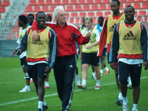 Photo: Coach Leo Beenhakker (centre), Trinidad and Tobago World Cup captain Dwight Yorke (left) and the country's record goal scorer Stern John at the 2006 World Cup. Chris Birchall (background centre) and Dennis Lawrence (background right) follow closely behind. Beenhakker has refused any TTFA role until all local coaches are paid.