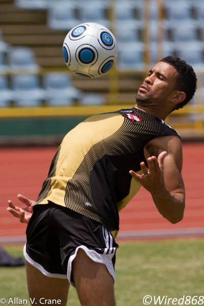 Photo: Veteran Trinidad and Tobago winger Carlos Edwards controls on his chest during training. (Courtesy Allan V Crane/Wired868)