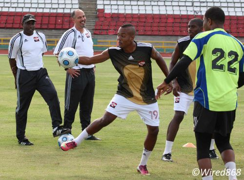 Photo: New Trinidad and Tobago coach Stephen Hart (second from left) holds his first training session. Around Hart are (from left) assistant coach Hutson Charles and players Curtis Gonzales, Kareem Moses and Cleon John. (Courtesy Wired868)