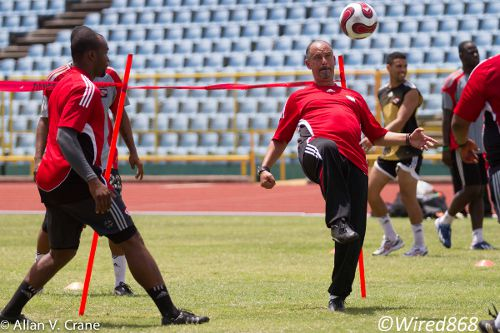 Photo: Trinidad and Tobago coach Stephen Hart shows off his touches while goalkeeper coach Jefferson George (left) looks on. (Courtesy Allan V Crane/Wired868)