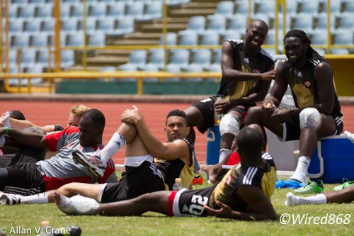 Photo: Trinidad and Tobago forwards Kenwyne Jones (seated right) and Cornell Glen share a joke while being iced during a national training session. (Courtesy Allan V Crane/Wired868)