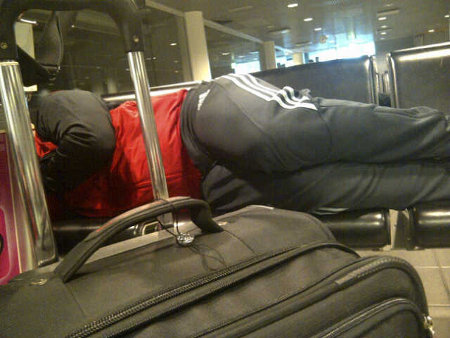 Photo: A member of Trinidad and Tobago's national football team gets some sleep at the international airport in Helsinki this month.