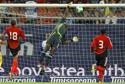 Photo: Trinidad and Tobago goalkeeper Marvin Phillip in action against Romania in May 2013. (Courtesy AP)