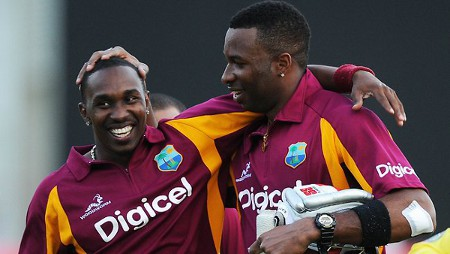 Photo: West Indies teammates Kieron Pollard (right) and Dwayne Bravo will face India in the opening ODI today.