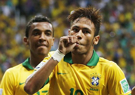 Photo:Brazil attacker Neymar (right) thinks it was child's play. At his left is midfielder Luiz Gustavo.