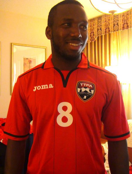 Photo: Trinidad and Tobago midfielder Khaleem Hyland tries on his new gear. (Courtesy TTFA Media)