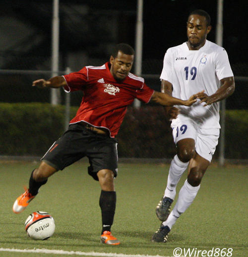 Photo: Ex-Central FC midfielder Hayden Tinto (left) drives at Police player Christon Thomas during the 2012/13 Pro League season. Tinto is one of several Pro League players who have joined the NSL this season. (Courtesy Wired868)