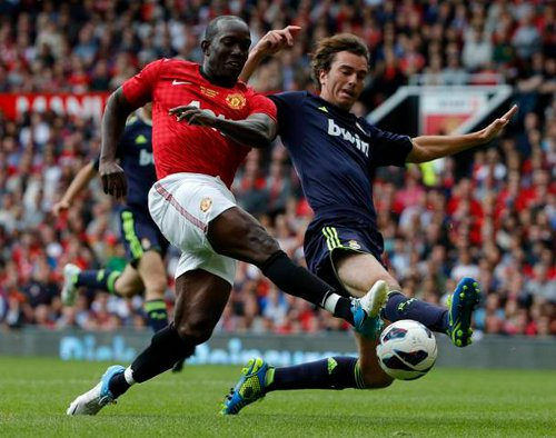 Photo: Former Trinidad and Tobago and Manchester United star Dwight Yorke (left) goes for goal against Real Madrid.