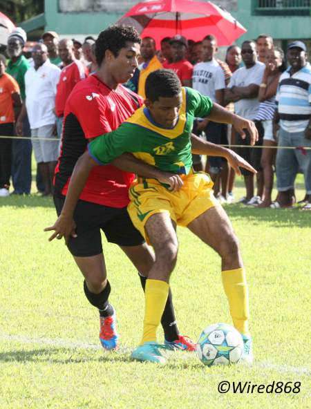 Photo: Teenaged Guaya United right back Marcus Ramkhelawan (right) holds off Westside Superstarz attacker Qian Grosvenor. (Courtesy Wired868)