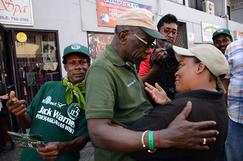 Photo: Believe you me, ma'am; I wish I had World Cup tickets to sell you! Jack Warner (centre) is Chaguanas West's problem now.