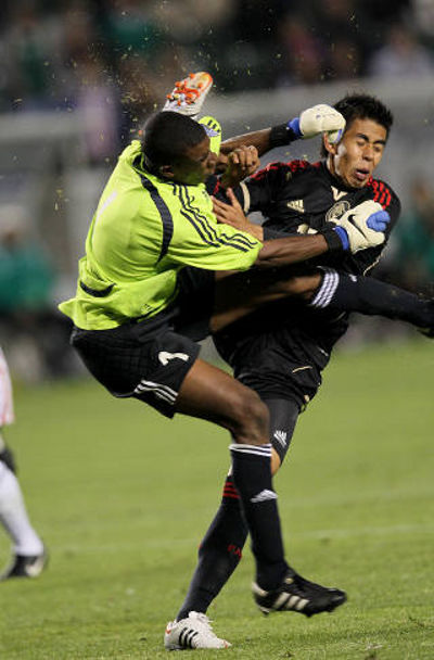 Photo: Trinidad and Tobago national under-23 goalkeeper Andre Marchan (left) is clattered by Nestor Calderon during a 7-1 Mexico win in the 2012 Olympic qualifiers. (Courtesy YahooSports)