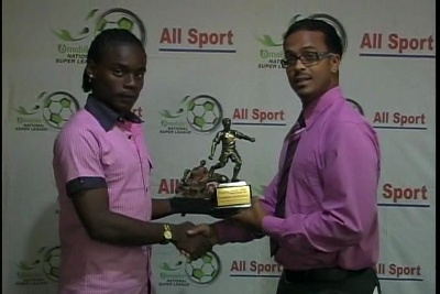 Photo: Ex-1976 FC Phoenix midfielder Darren Mitchell (left) receives his National Super League MVP award from Blink/bMobile corporate manager Garvin Warwick.