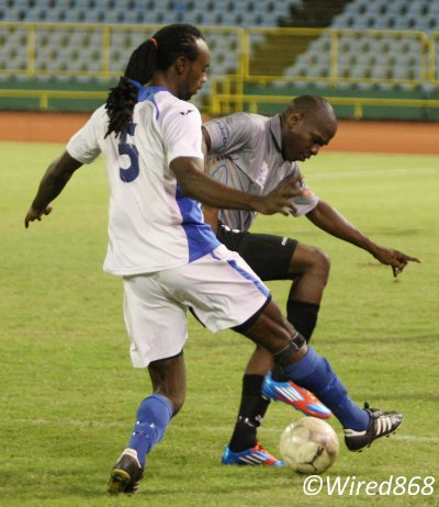 Photo: WASA defender Akil Harley (left) tackles St Ann's Rangers hitman Devon Modeste during last season's Toyota Classic Cup match. The pair might cross swords again tomorrow. (Courtesy Wired868)