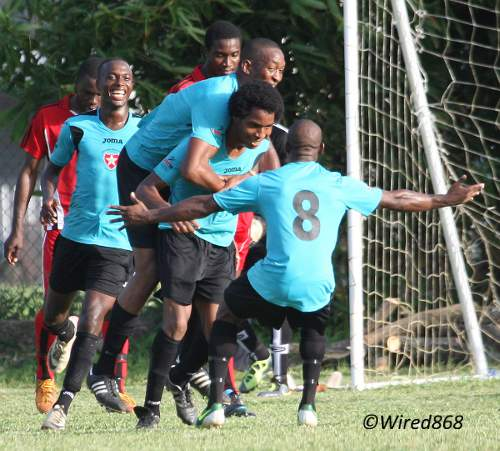 Photo: Westside Superstarz defender Akim Ash (second from right) is congratulated by teammates after scoring the opening goal against 1976 FC Phoenix yesterday afternoon. (Courtesy Wired868)