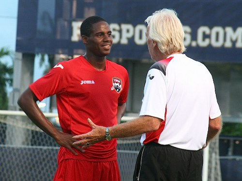 Photo: Former World Cup 206 coach Leo Beenhakker (right) makes a point to Trinidad and Tobago utility player Joevin Jones during the CONCACAF Gold Cup. (Courtesy TTFA Media)