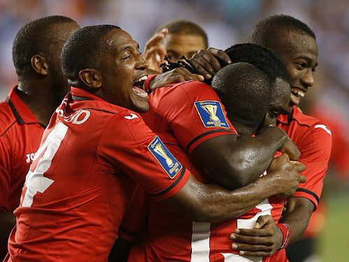 Photo: The Trinidad and Tobago national football team celebrates during the 2013 CONCACAF Gold Cup. (Courtesy CONCACAF)