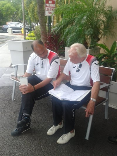 Photo: TTFA director of football Leo Beenhakker (right) makes a point to head coach Stephen Hart in Fort Lauderdale. (Courtesy TTFA Media)