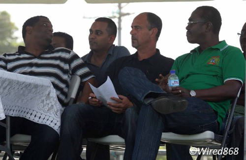 Photo: Trinidad and Tobago national coach Stephen Hart (second from right) takes in some NSL action in Guayaguayare with TTFA general secretary Sheldon Phillips (far left), press officer Shaun Fuentes (second from left) and the Guayaguayare councillor. (Courtesy Wired868)
