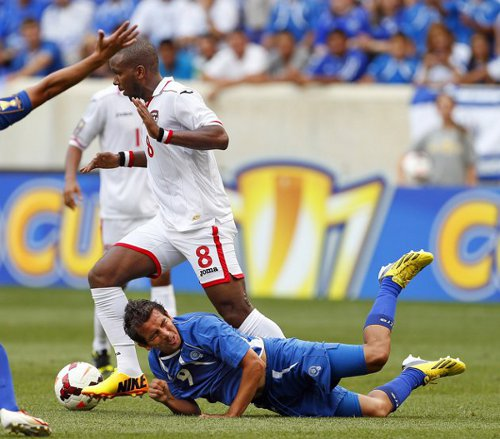 Photo: Trinidad and Tobago midfielder Khaleem Hyland (centre) in action against El Salvador in the 2013 Gold Cup. (Courtesy CONCACAF)