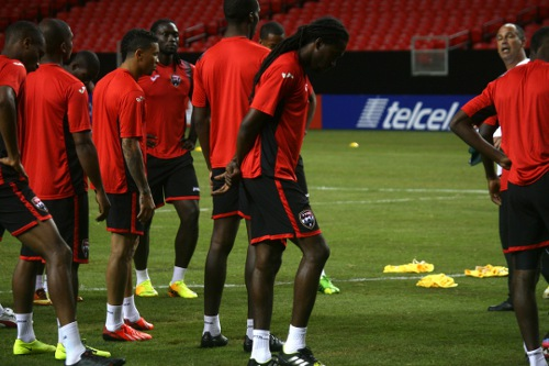 Photo: Trinidad and Tobago midfielder Keon Daniel (third from right) is focused on getting the job done in the 2013 CONCACAF Gold Cup quarterfinals against Mexico. (Courtesy TTFA Media)