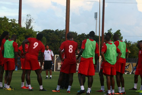 "Photo: Trinidad and Tobago assistant coach Derek King (centre) offers advice to the ""Soca Warriors."" (Courtesy TTFA Media)"