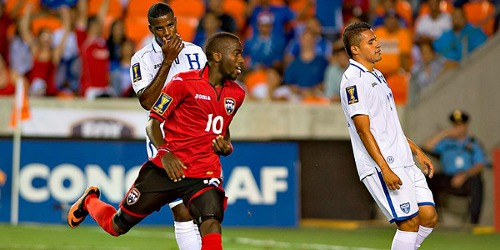 Photo: Kevin Molino (centre) reacts after scoring Trinidad and Tobago's second goal against Honduras last night. (Courtesy CONCACAF)