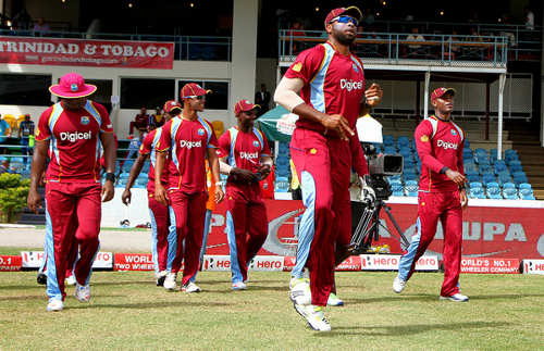 Photo: Stand-in West Indies cricket captain Kieron Pollard (centre) leads out the troops. (Courtesy Westindiescricket)