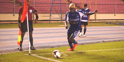 Photo Arabe Unido attacker Jose Gonzales takes a corner kick against W Connection. Gonzales scored Arabe's third goal last night. (Courtesy CONCACAF)