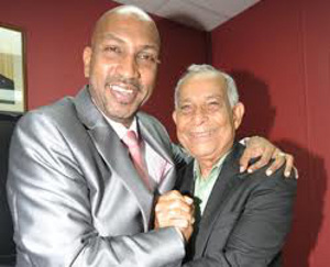 Photo: Sport Minister Anil Roberts (left) with former TTFF president Oliver Camps.
