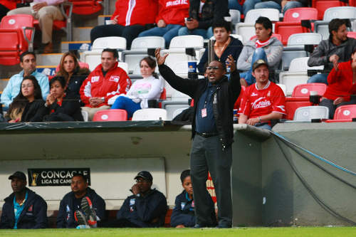 Photo: Caledonia AIA coach Jamaal Shabazz tries to inspire his charges against Toluca in Mexico City. (Courtesy Francisco Estrada/JAM Media)