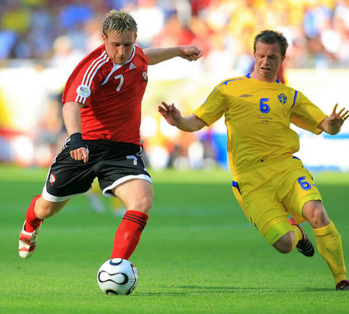 Photo: Chris Birchall (left) goes for goal against Sweden at the 2006 World Cup.