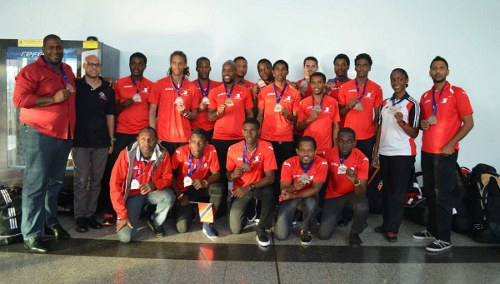 Photo: The Trinidad and Tobago national men's hockey team show off their medals at the Piarco International Airport.