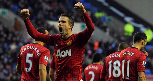 Photo: Robin Van Persie celebrates with his Manchester United teammates. (Courtesy SkySports)