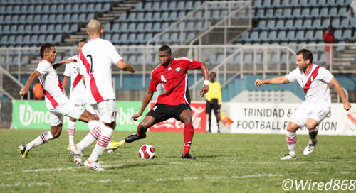 Photo: Trinidad and Tobago defender Sheldon Bateau (centre) made his international senior debut against Peru in February. Bateau will rejoin the Soca Warriors in Saudi Arabia after missing out on the CONCACAF Gold Cup. (Courtesy Allan V Crane/Wired868)