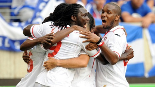 "Photo: The ""Soca Warriors"" celebrate a goal against El Salvador during the 2013 CONCACAF Gold Cup. (Courtesy CONCACAF)"
