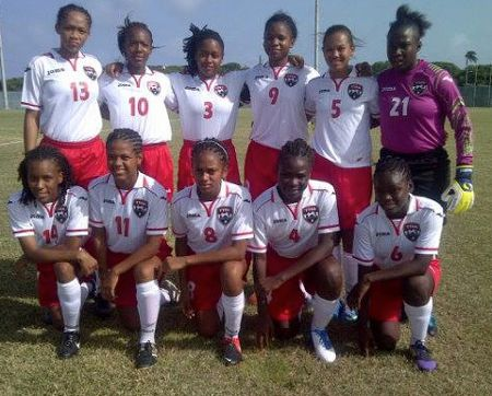Photo: The Trinidad and Tobago national under-17 women pose before action against St Kitts and Nevis. Coach Marlon Charles had just 14 players to choose from today. (Courtesy TTFA Media)